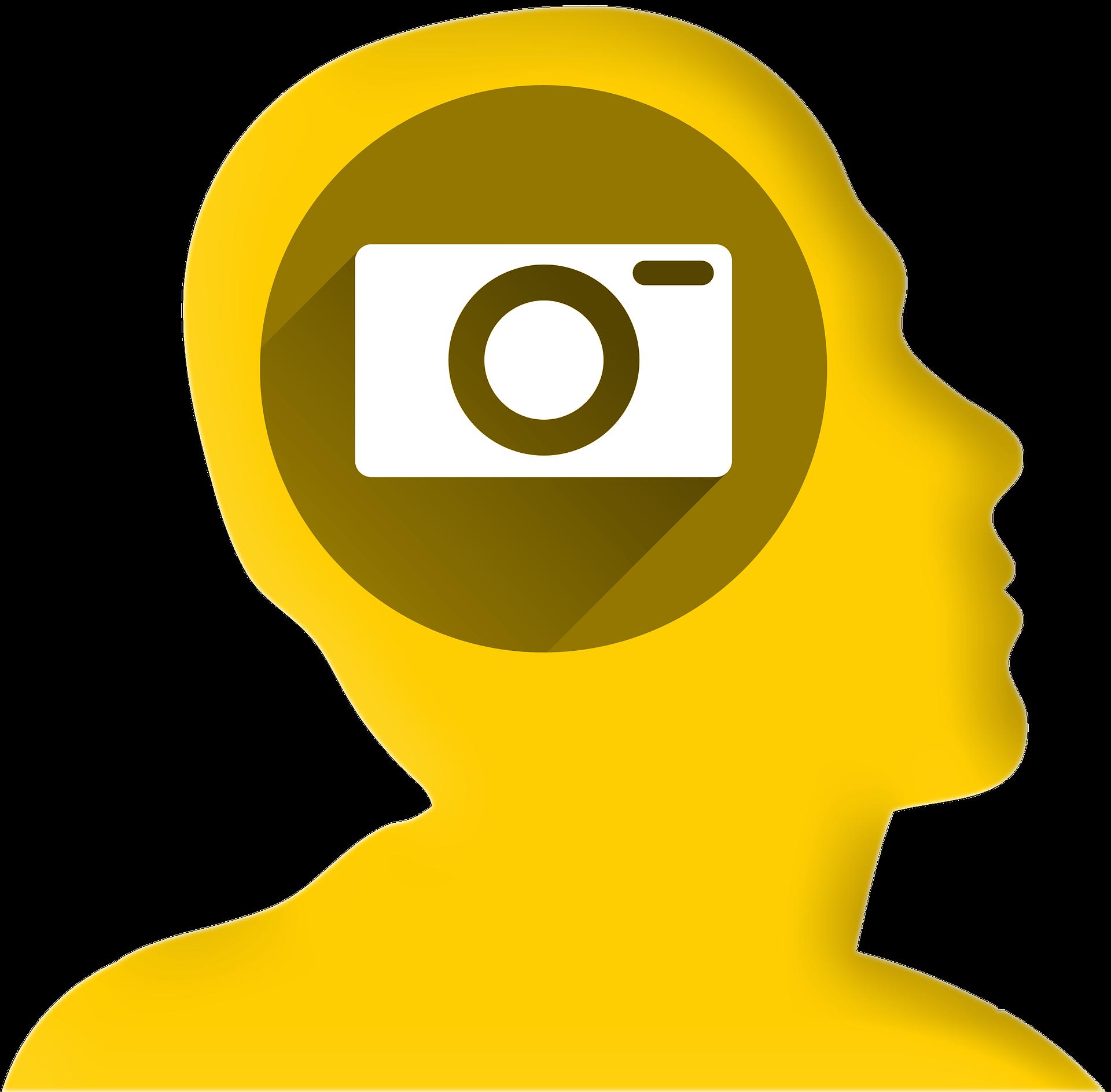 Vereinfachte Darstellung eines Kopfes mit einem Fotoapparat in der Mitte